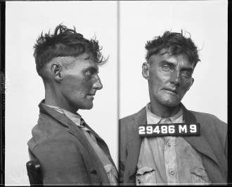 Booking photo of a Depression-era vagrant