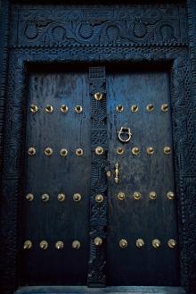 Traditional carved wooden door in Stone Town, Zanzibar, Tanzania, East Africa, Africa